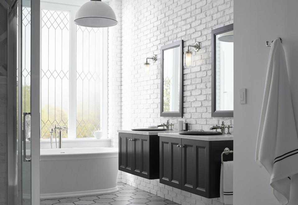 The cabinets and mirror, as well as the bathtub are part of the Kohler Clerestory Bathroom collection