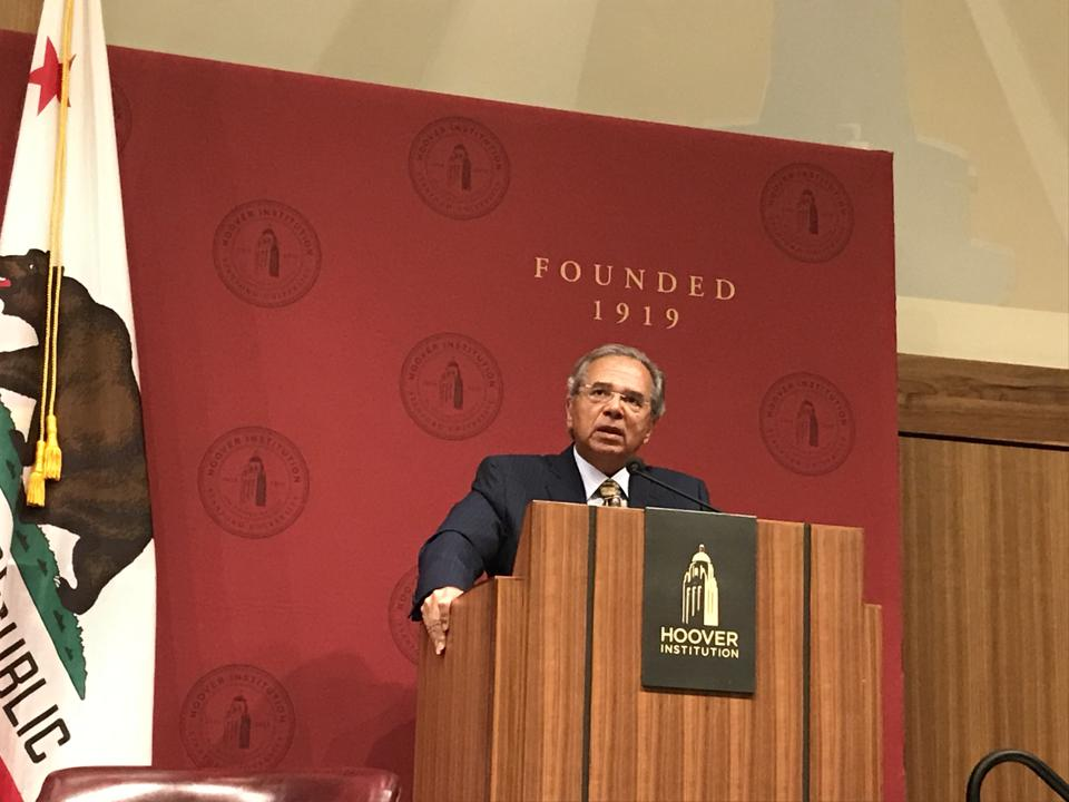 Paulo Guedes speaking at a conference at the Hoover Institution