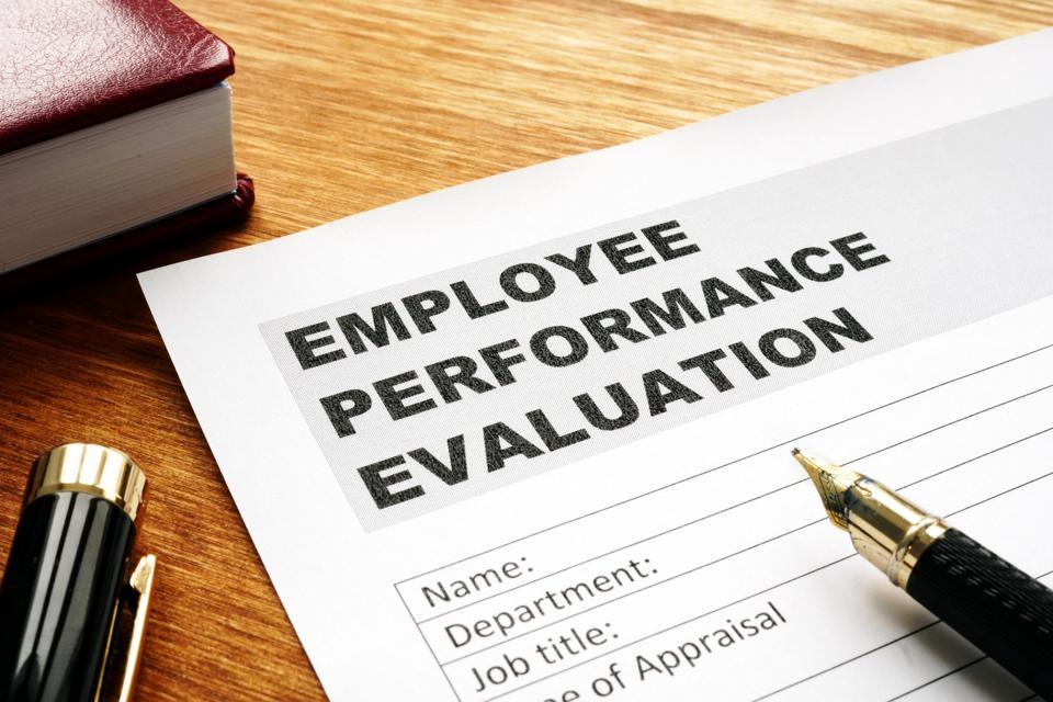 Employee performance evaluation form on a desk.