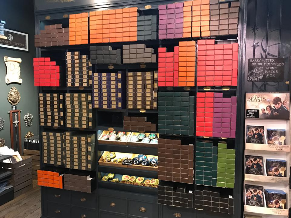 Boxes of wands pack the shelves of the Harry Potter stores