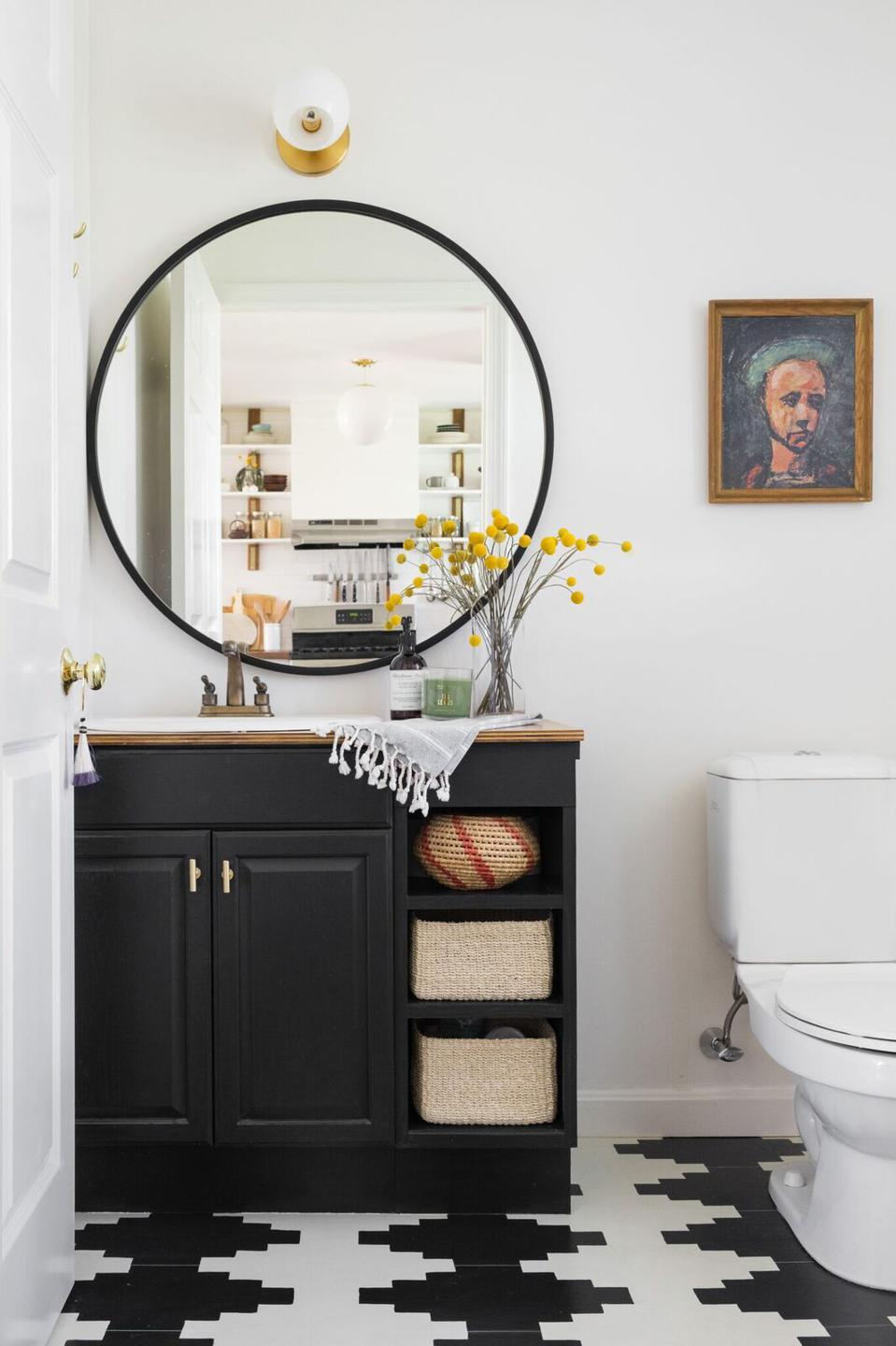 This black and white bathroom was designed by Shannon Tate Interiors.