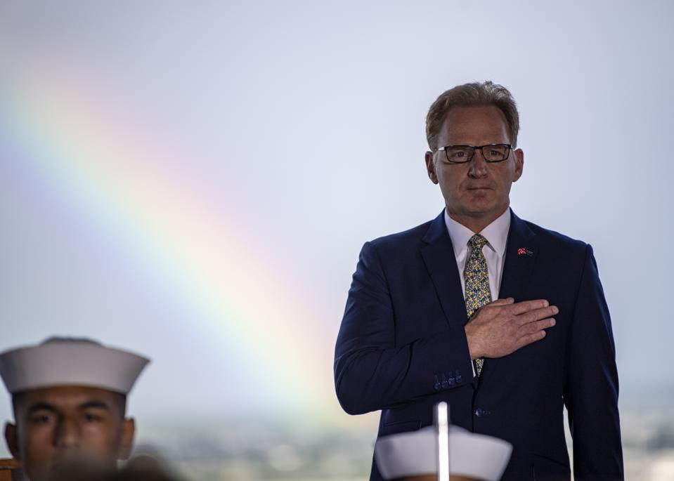 A rainbow shines as Acting Secretary Modly conducts the naming ceremony for the future USS Doris Miller