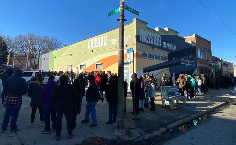 Customers line up outside Mission's South Shore dispensary in Chicago on Jan. 1, 2020, the first day of adult-use cannabis sales in Illinois.