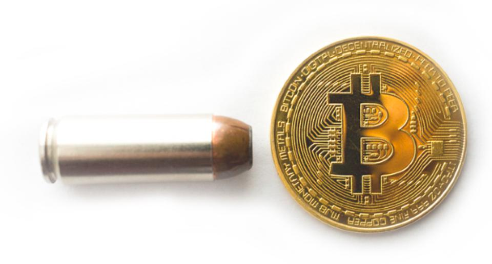 Picture of a Bullet and a Bitcoin, indicating the ties of crypto in funding terrorism.