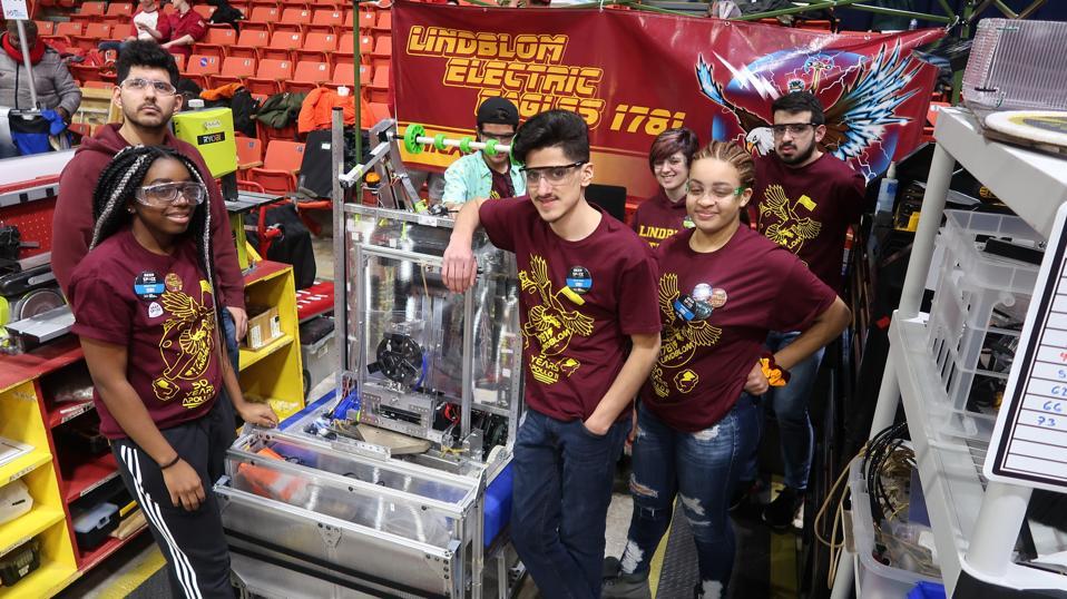Seven Lindblom robotics students at a science fair.