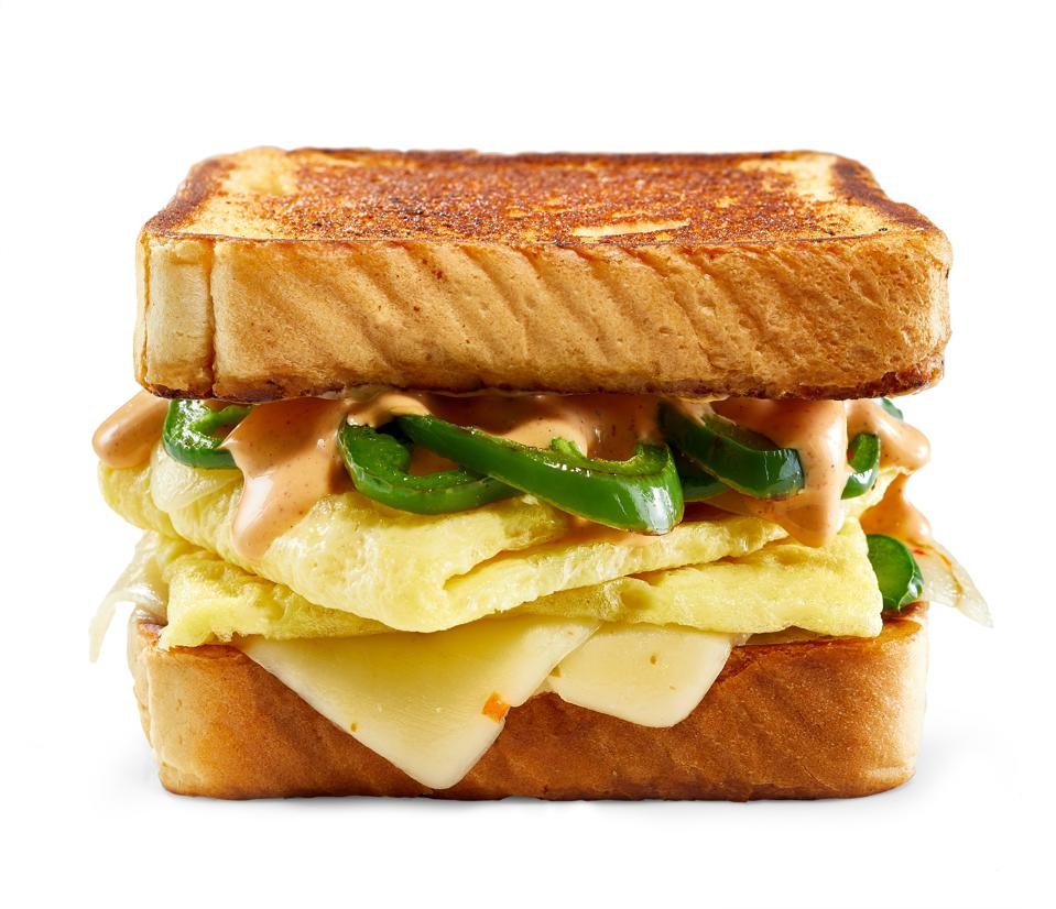 JUSTEgg in sandwich with jalapeños, sauce and cheese.
