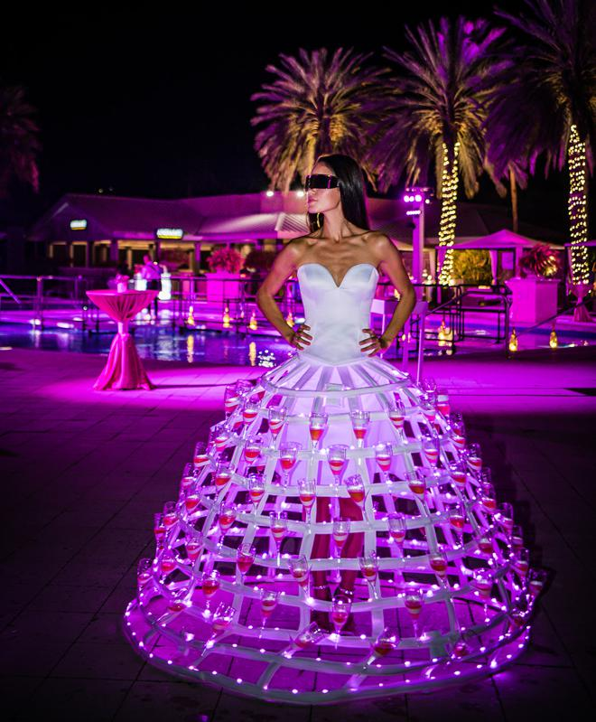 Hoop skirts adorned with pink champagne flutes at Cayman Cookout 2020