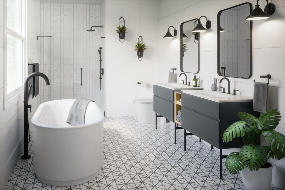 All of the accessories in this bathroom are black including the mirrors, light fixtures, and fittings.