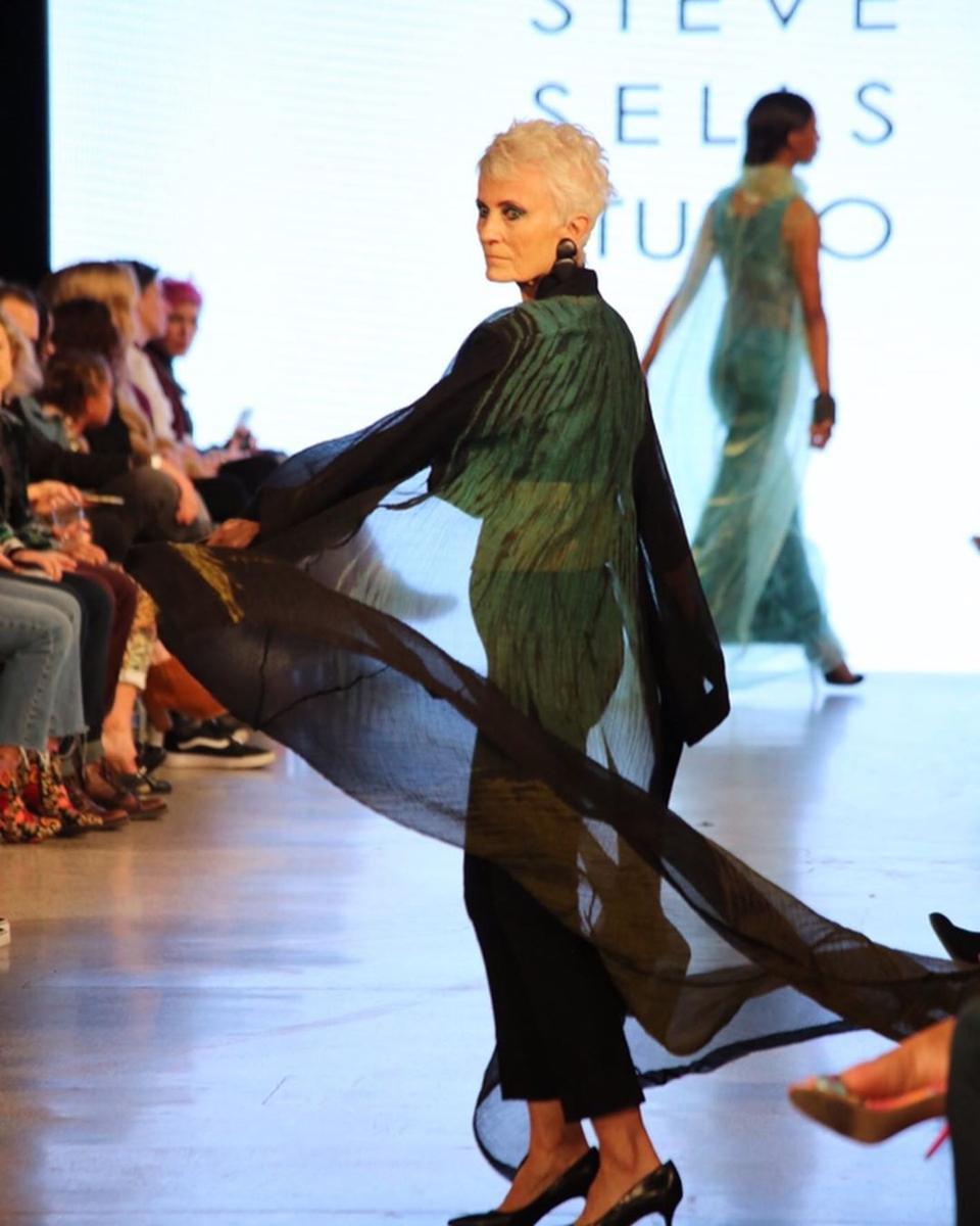 A model wears Steve Sells design during Denver Fashion Week