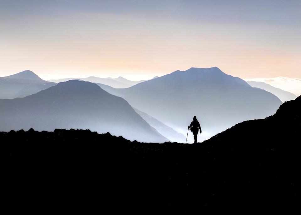 Lonely walker in the Scottish Highlands