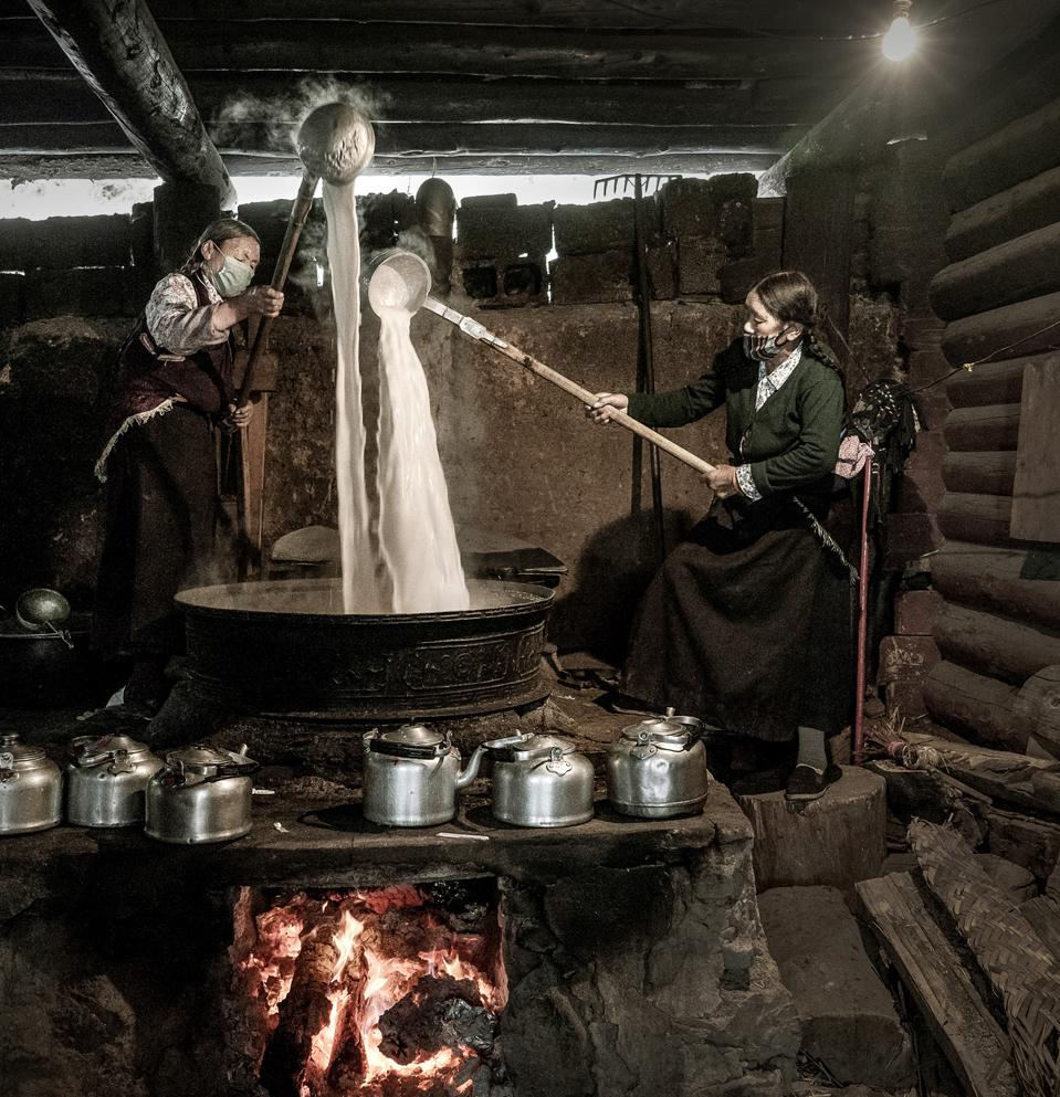 Two Tibetan women making butter tea, People & Cultures