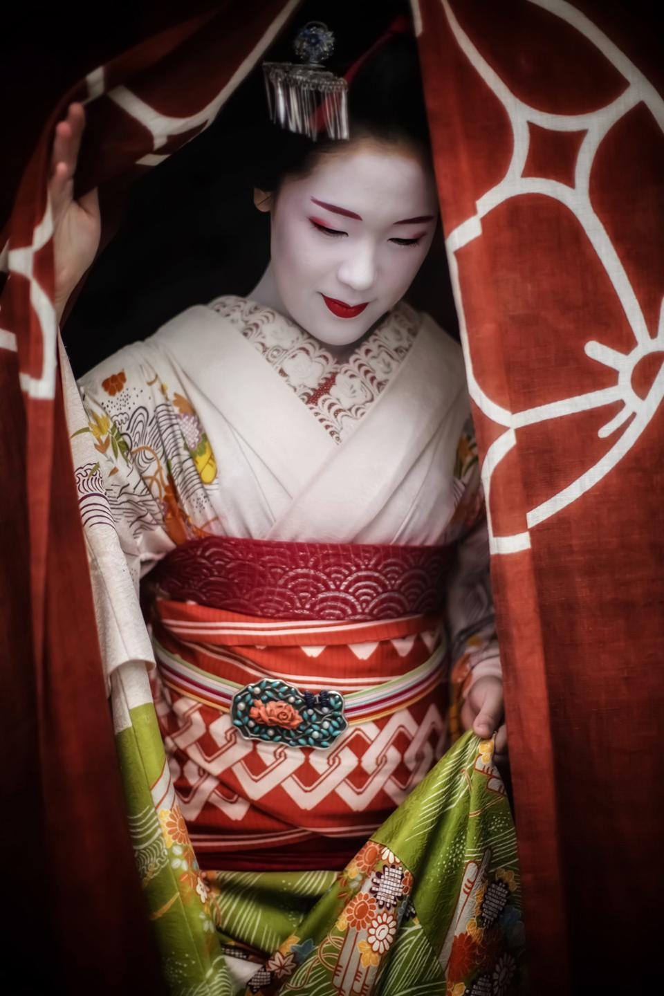 Beautiful  Geisha coming out of a teahouse, People & Cultures