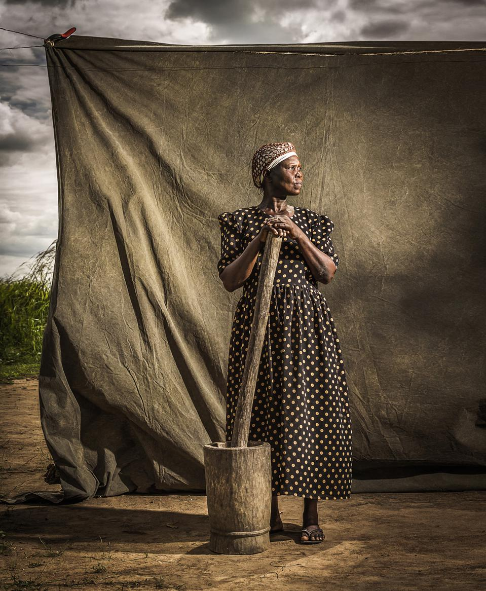 Beautiful woman with  her mortar in Uganda, People & Cultures