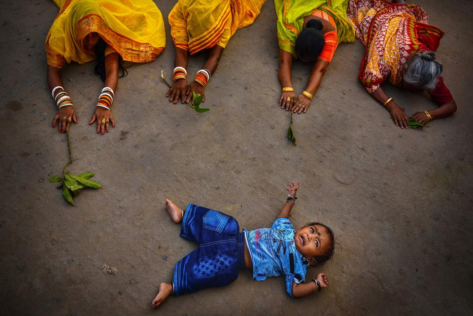 Hindu women performing penance around baby in India, People & Cultures