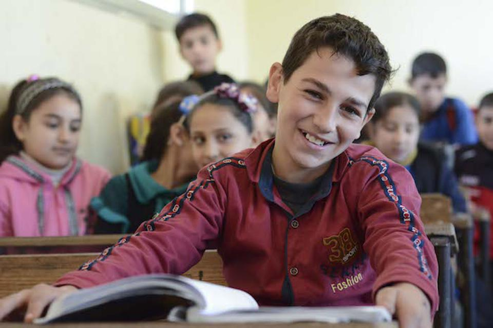 Yousef, 10, of embattled Homs, Syria, studied in a dark, dusty basement for three years after his school was damaged by fighting. In 2018, his school was rehabilitated thanks to UNICEF and partner Educate A Child.
