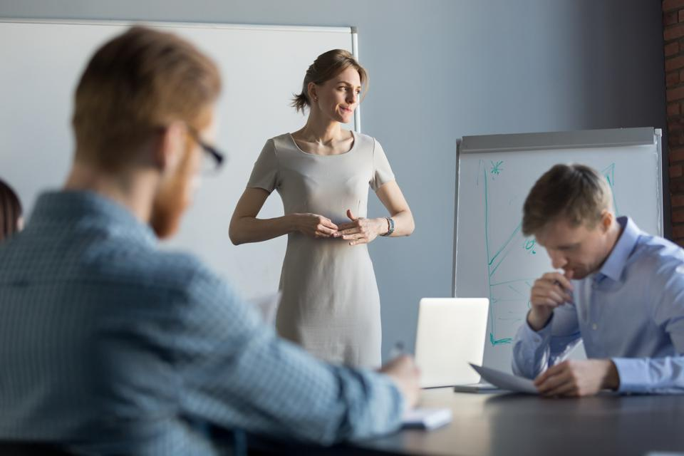 Stressed business woman feeling nervous thinking of problem at meeting