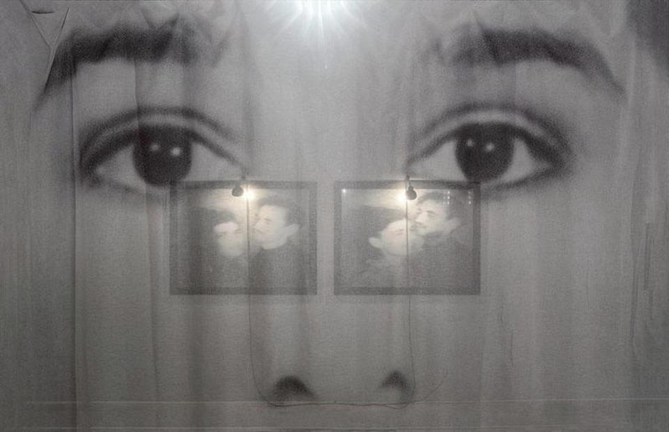 A pair of eyes, black and white photograph, printed on fabric.