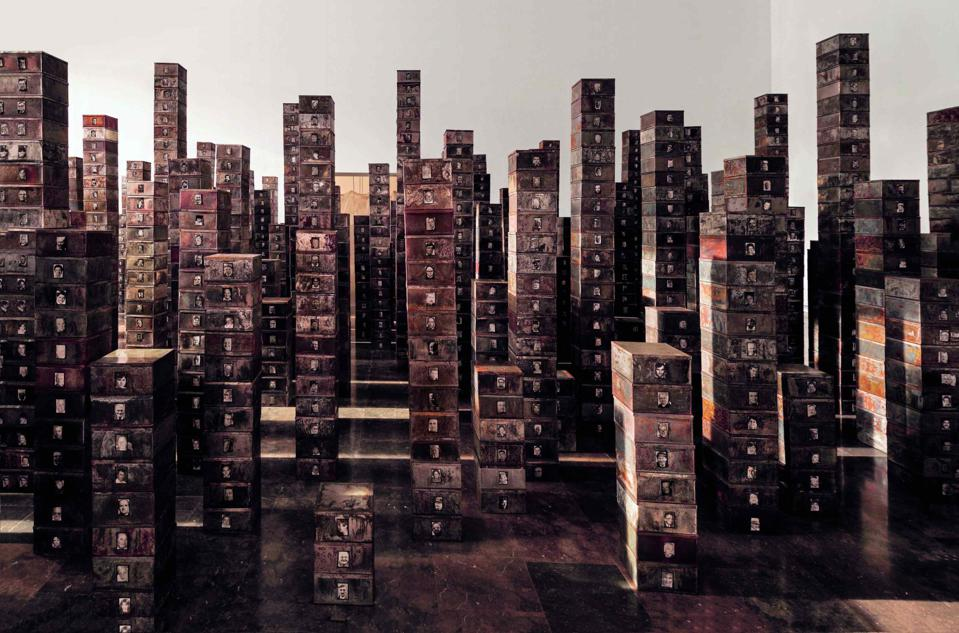 Towers of boxes containing smiling portraits of souls departed.