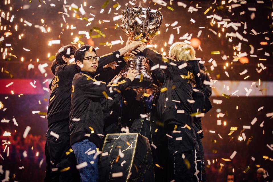 FunPlus Phoenix lift the League of Legends World Championship trophy.