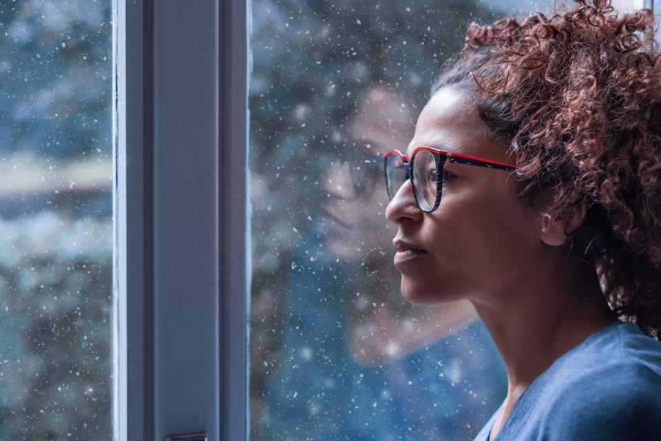 Woman looking out of the window.