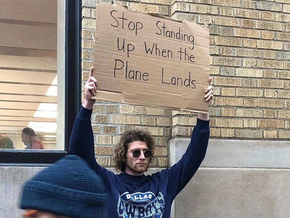 Seth Phillips, known from the Instagram account Dude With Sign, protests common, everyday, relatable issues.