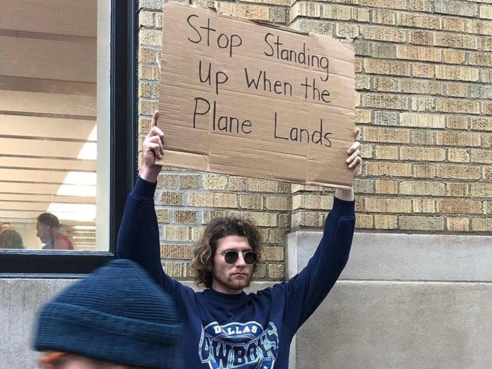 Seth Jacobs, known from the Instagram account Dude With Sign, protests common, everyday, relatable issues.