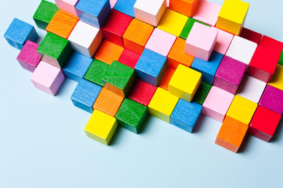 Color cubes in the puzzle. Concept creative, logical thinking, art