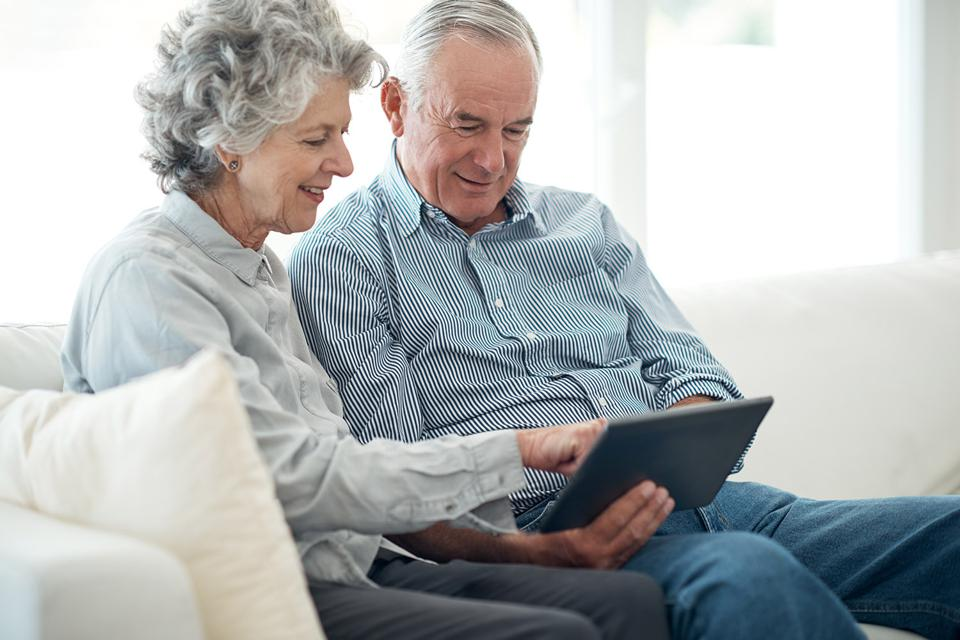 Mature couple reviews their retirement accounts