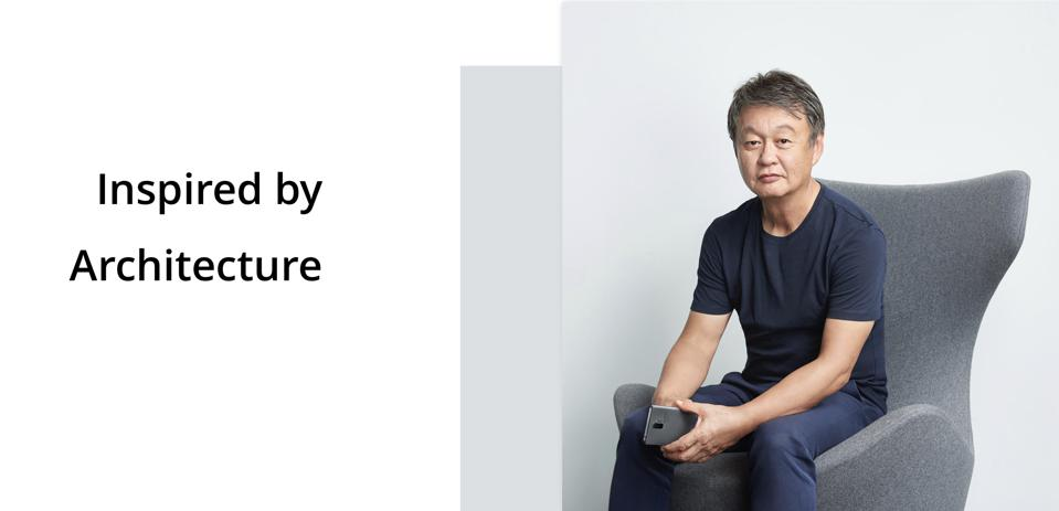 Promotional material from Realme showing a portrait of Japanese designer Naoto Fukasawa.