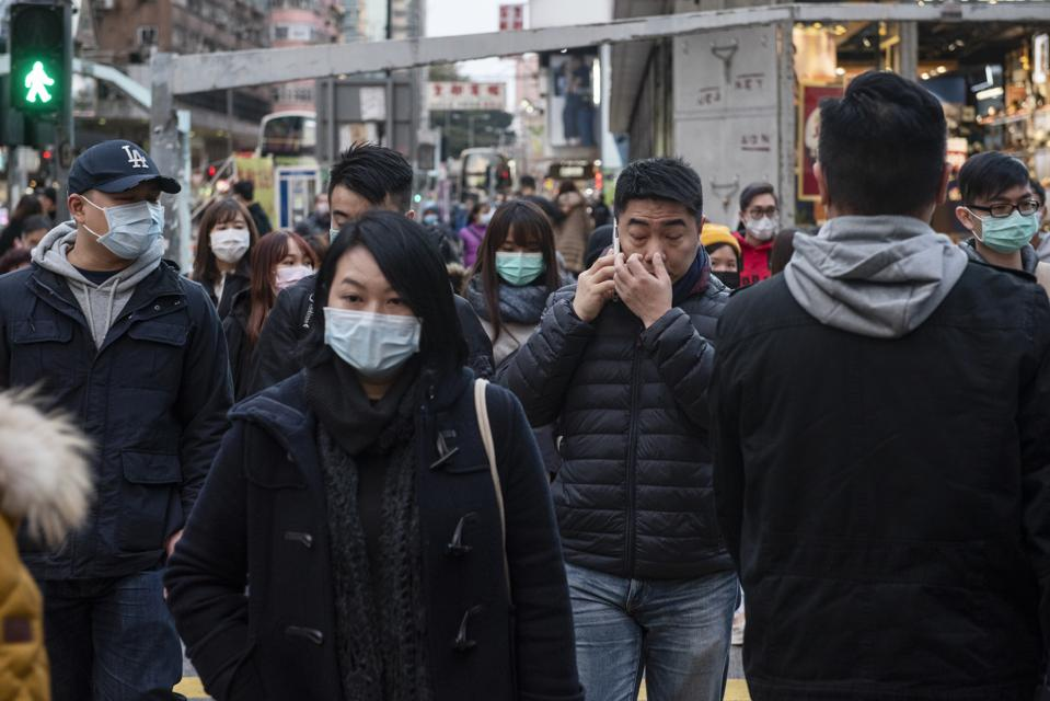 Pedestrians with sanitary masks to prevent infections. Since...