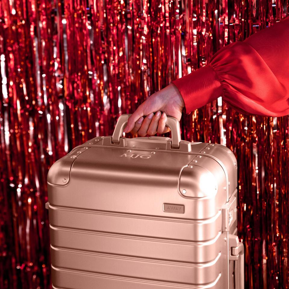 Away's Aluminum Edition Carry-On in rose gold