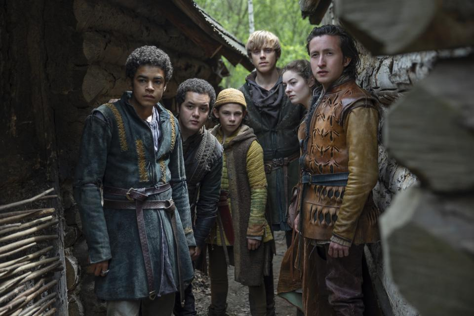 Amir Wilson, left, plays a 15-year-old squire tasked with delivering a top-secret letter to the king.