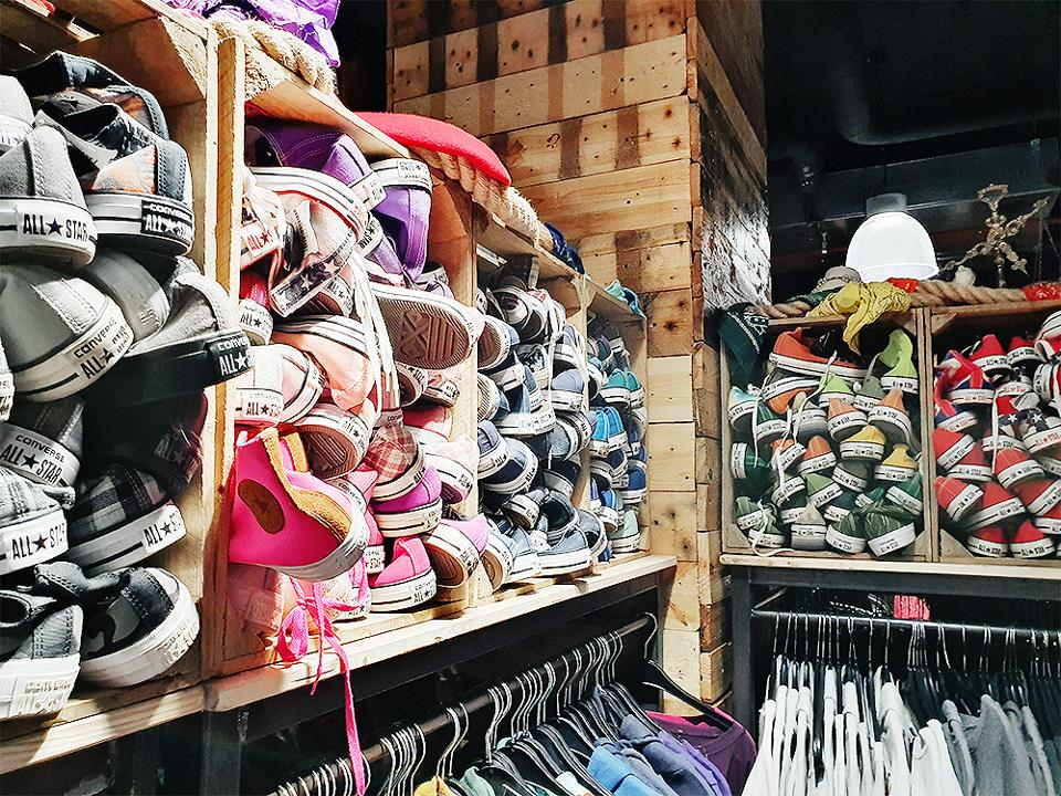 Crates of Converse All-Stars for sale at Picknweight London