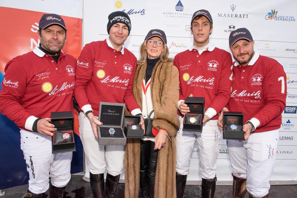 The Snow Polo World Cup St. Moritz Trophy, sponsored by Chopard, was presented by Evelyne Sutter, Manager of the Chopard Boutique St. Moritz and Marijana Jakic, Brand Manager St. Moritz to Valery Mishchenko. The four winning players each received a Mille Miglia Chopard watch.