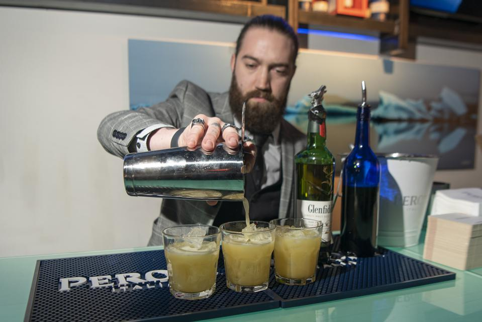 Isaac William Viner mixes up Glenfiddich's Fire & Ice cocktails.