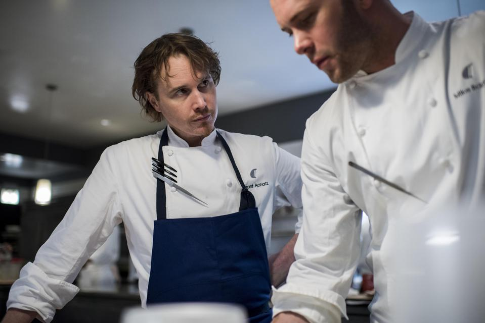 Mike Bagale with Alinea's chef-owner Grant Achatz in 2015.