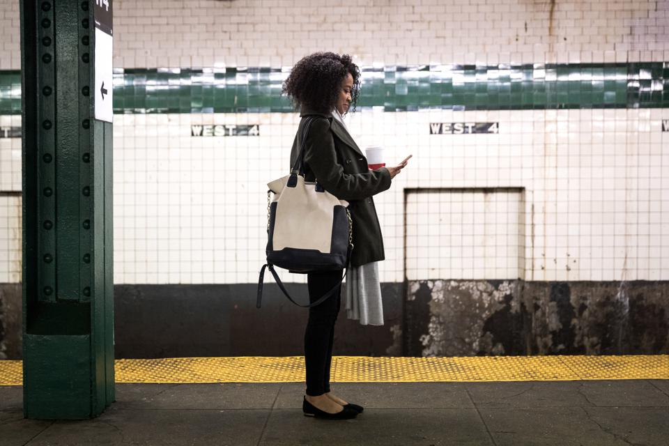 woman standing in subway