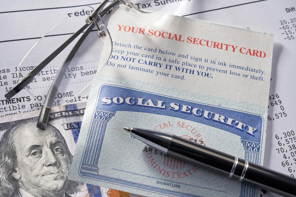 Social Security Card with money pen and glasses: $100 dollars