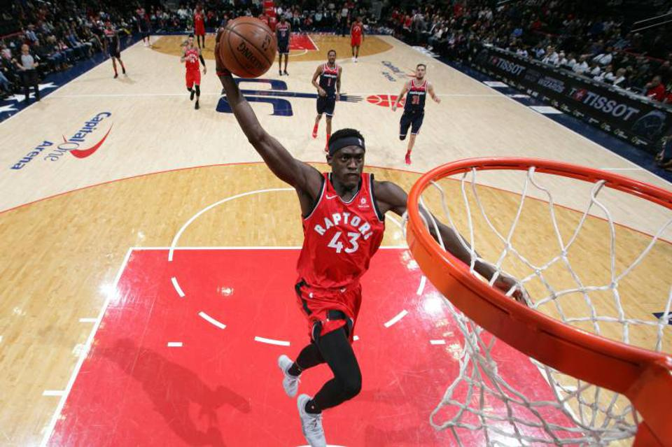 Pascal Siakam with a one-handed jam.
