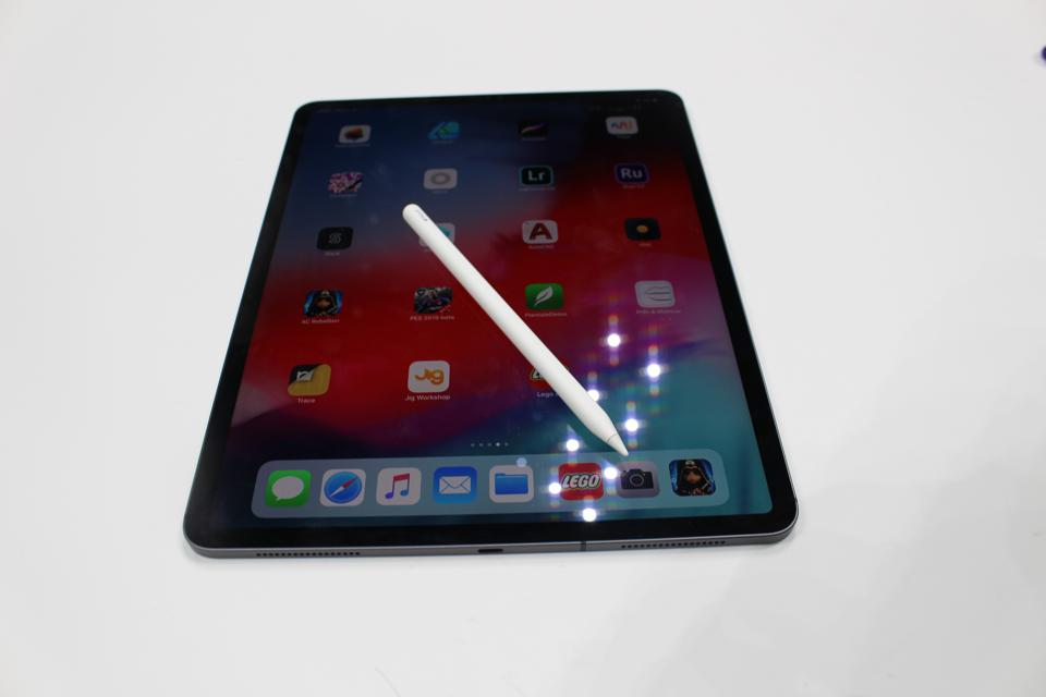 Apple iPad Pro with Pencil lying on top.