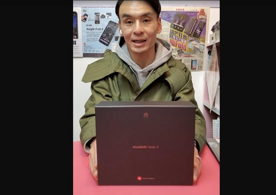Trinity Electronics shop owner Simon showing a retail unit of the Huawei Mate X.
