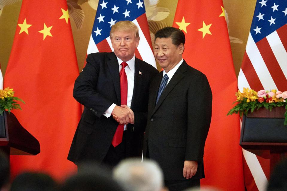 US President Donald Trump (L) and China's President Xi Jinping shake hands