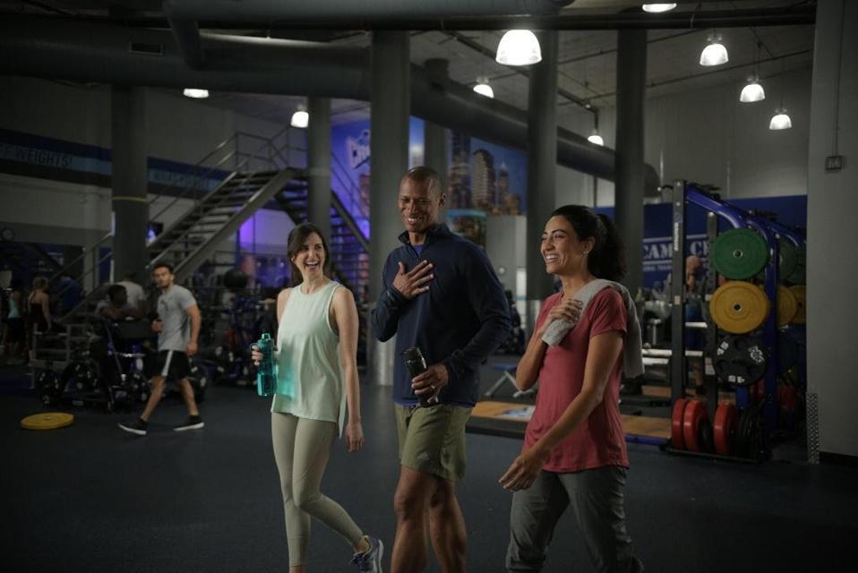 people walking in gym