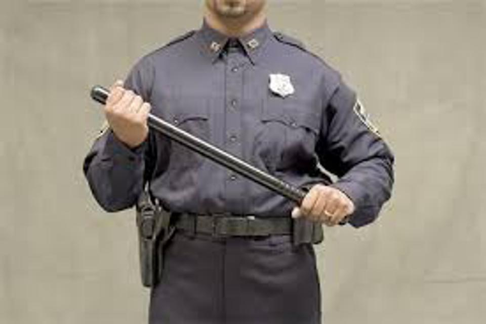 Police with billy club