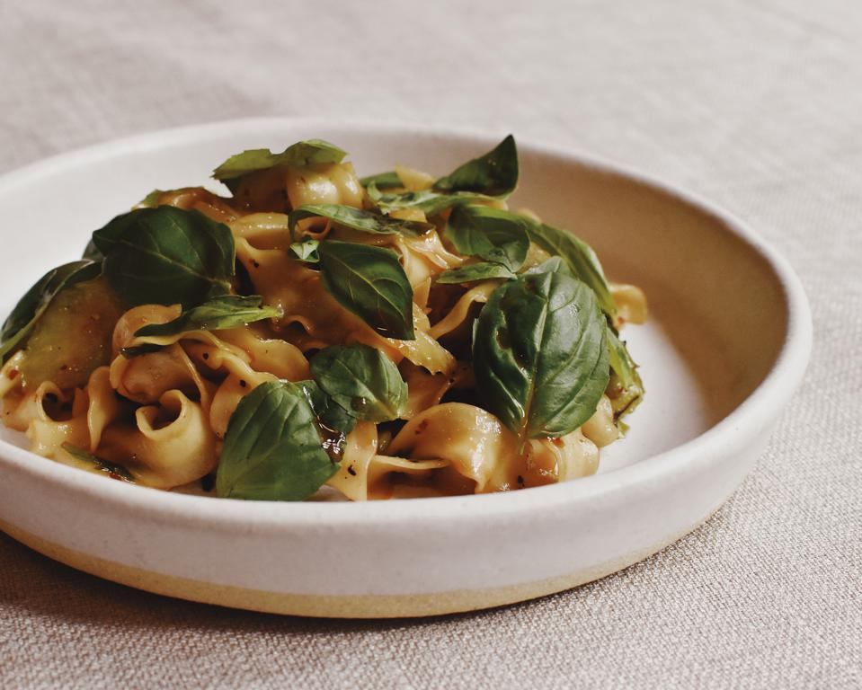 Noodles with Sichuan mala oil, South American brazilian nuts and fresh basil.