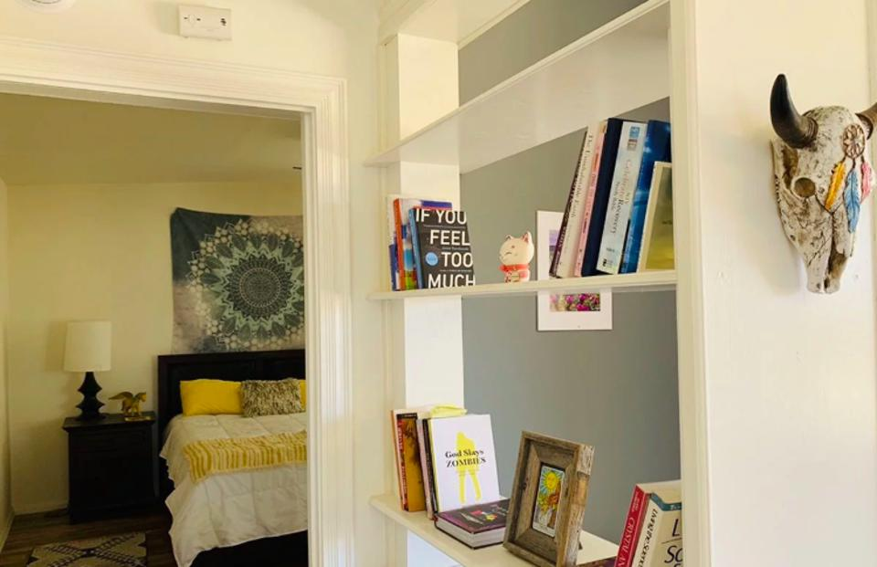 Bedroom and bookshelf of a California Airbnb