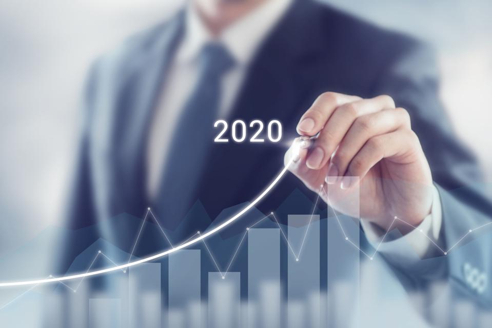 Growth success in 2020 concept. Businessman plan and increase of positive indicators in his business.