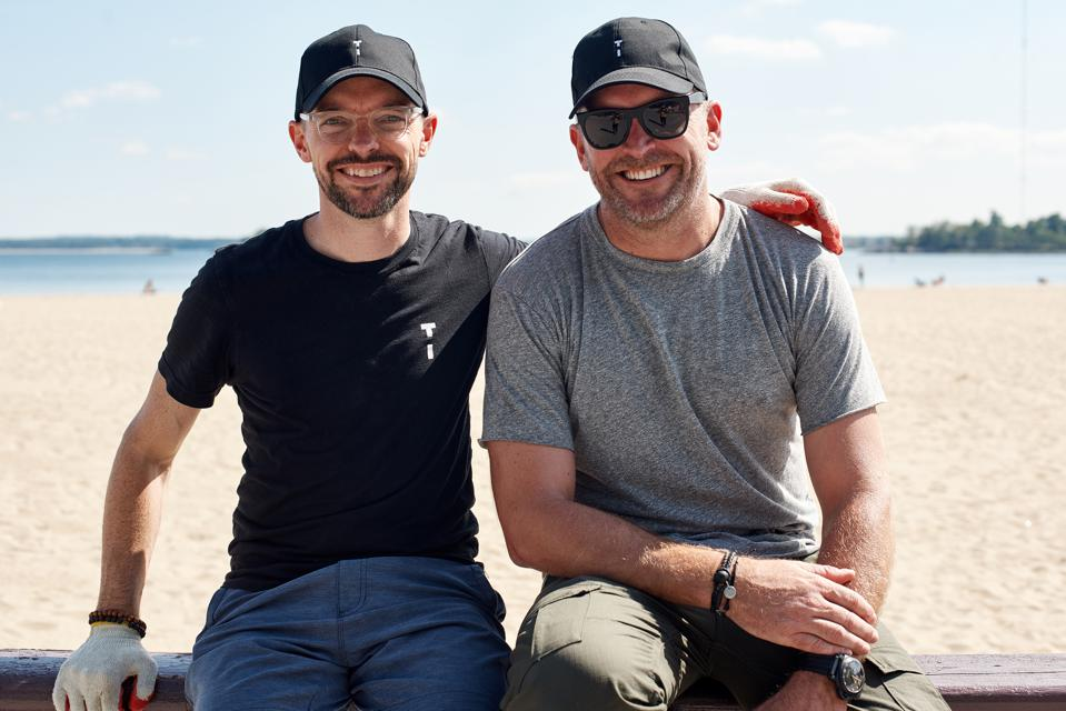 Co-founders and brothers (L) Tim Gibb and (R) Tommy Gibb at TIDAL New York's second annual beach clean up at Orchard Beach in partnership with 1% For The Planet and Surfrider New York.