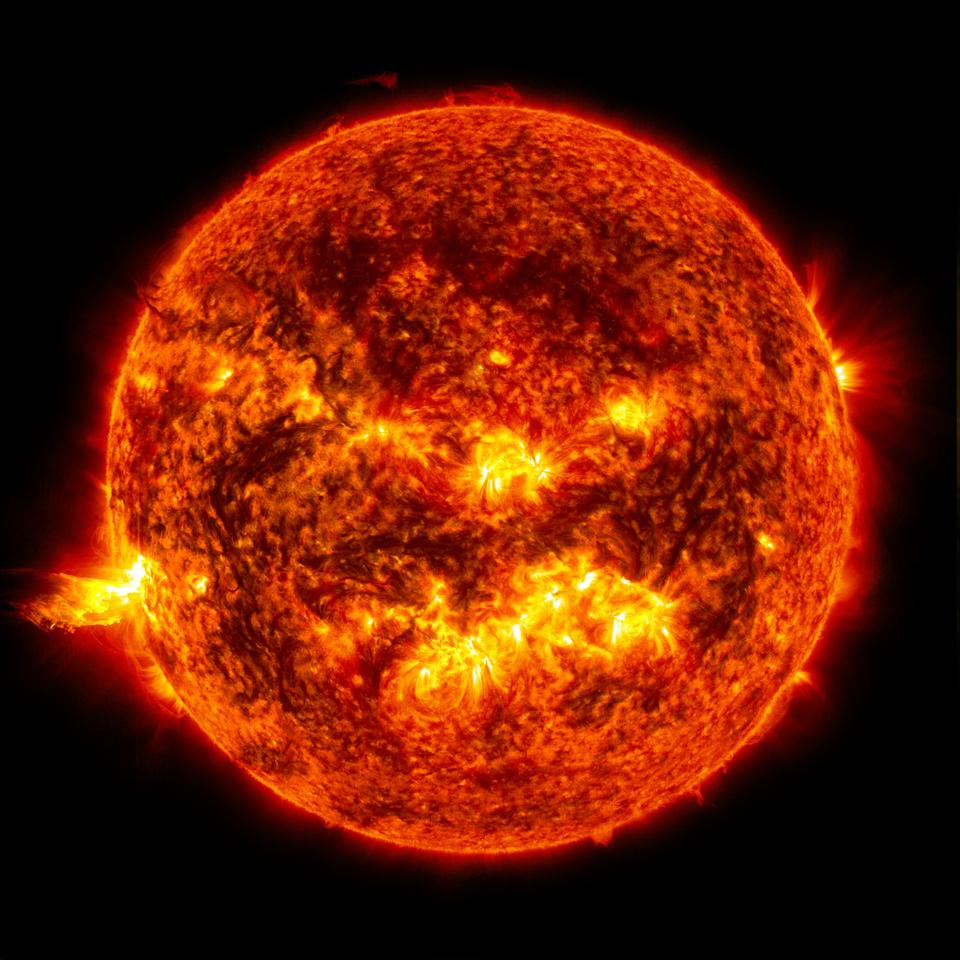 Sun image with solar flare and eruption of solar material by NASA/SDO