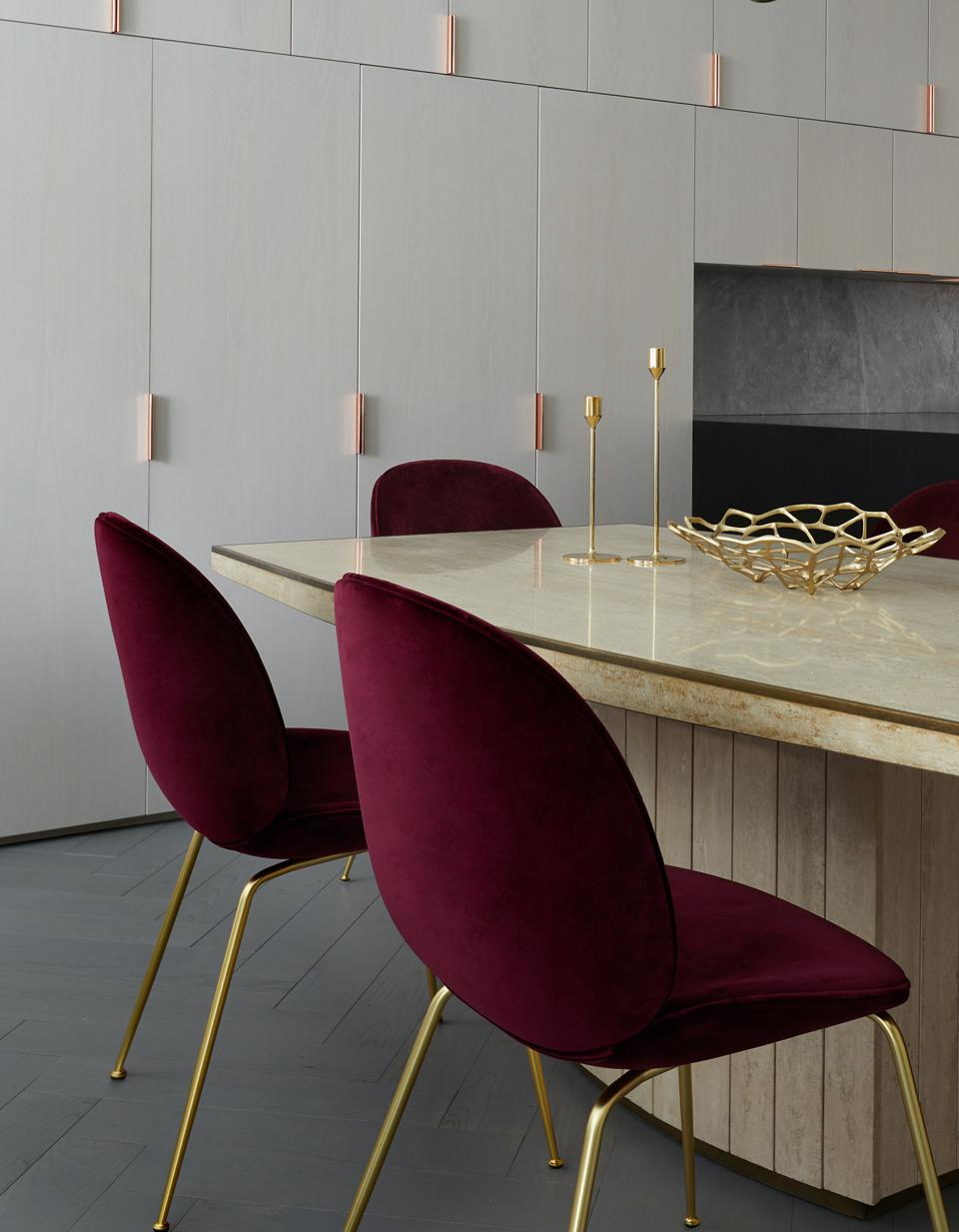 The dining area features a table by Willy Rizzo, and Beetle Chairs by Gubi.